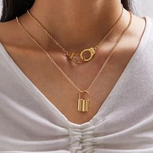 Jewelry - NWT Gold Lock & Handcuff One Set Layered Necklace